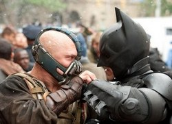 Tom Hardy as Bane battles Christian Bale as Batman in one of the top films of 2012, The Dark Knight Rises