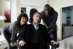 Anne Le Ny, François Cluzet and Omar Sy in one of the top dramas movies of 2012, The Intouchables