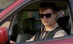 Ansel Elgort puts on some driving music in the top 2017 action film, Baby Driver.