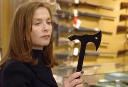 Isabelle Huppert contemplates her sublime revenge in the top 2016 thriller, Elle.